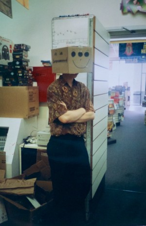 The author, guarding the back room with box on head. In my shirt's defense, it was the 1990s. Everyone dressed like this.