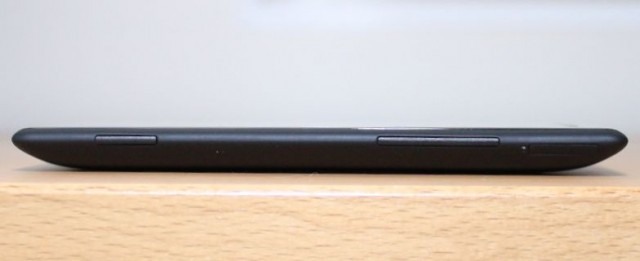Left to right: the HTC's camera button, volume rocker, and SIM compartment.