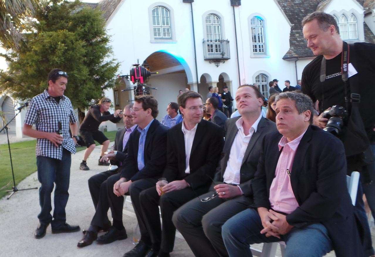 Prime seats were available to Robert Amsterdam (far right, pink shirt), the newest addition to the Dotcom legal team by way of the Washington, DC and London-based Amsterdam & Partners. Left to right: Lentino (standing), former Megaupload staffer Emmanuel Gadaix, Rothken, Ortmann, Van der Kolk, then Amsterdam.