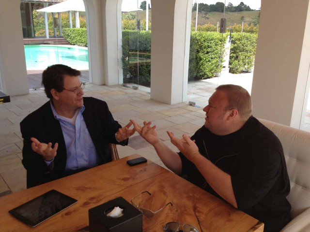 Dotcom discussing last-minute tweaks to Mega with his lawyer Ira Rothken.