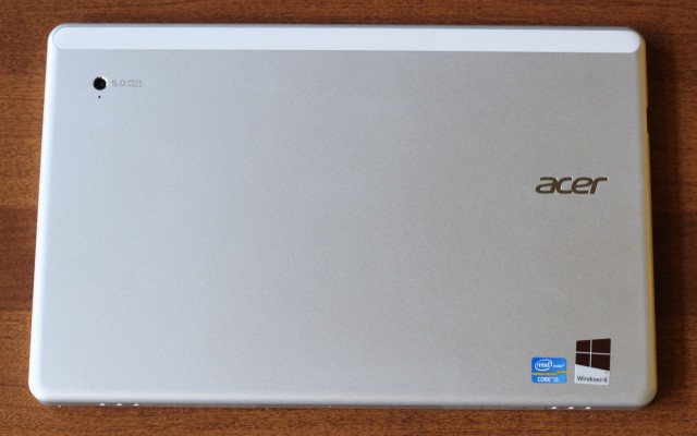 The back of the tablet is flat with slightly rounded edges.