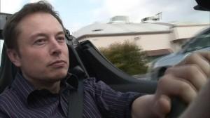 Elon Musk in a Tesla.