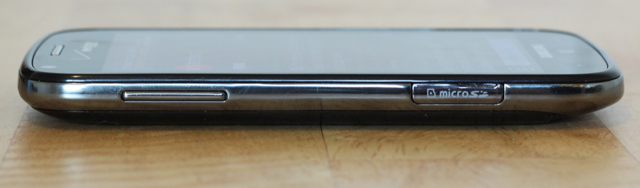 The volume rocker and microSD card slot on the phone's left side.