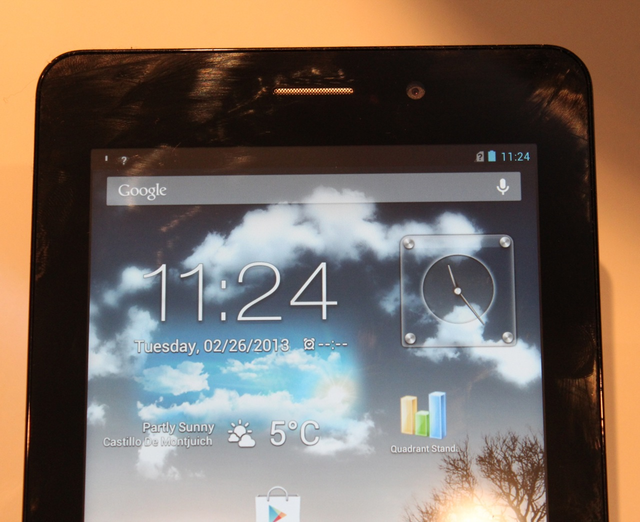 The tablet has a small speaker grille above the screen for use while making calls.