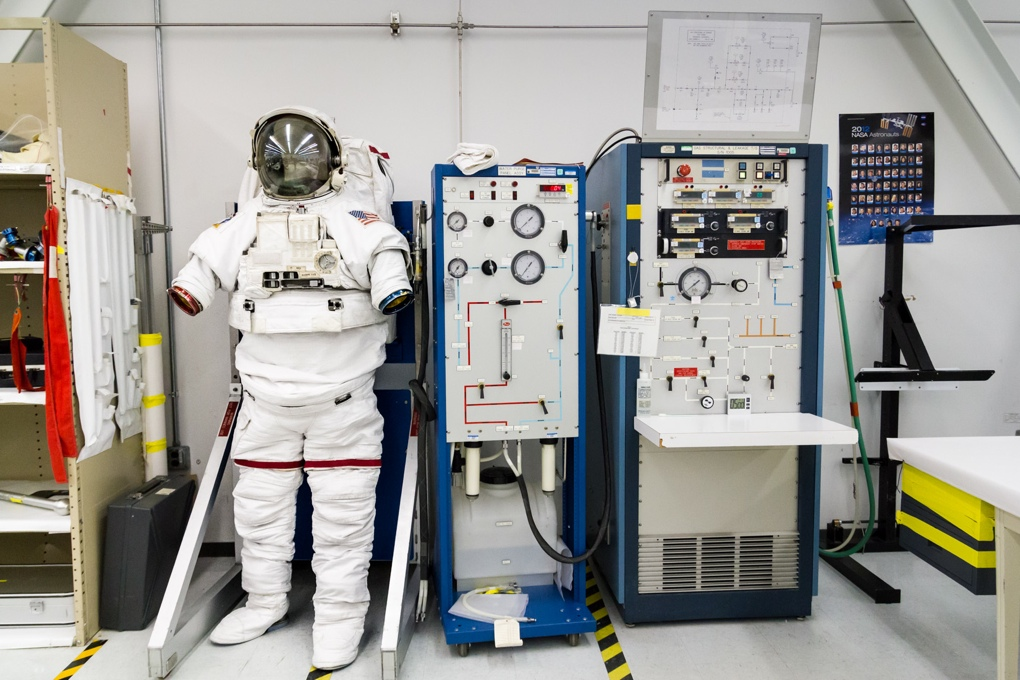 An EMU demonstrator stands on one wall. Burt Knight used this to give us a good feel for a spacesuit's controls.
