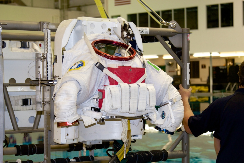 The upper half of Astronaut Luca Parmitano's extravehicular mobility unit, mounted on the donning stand.