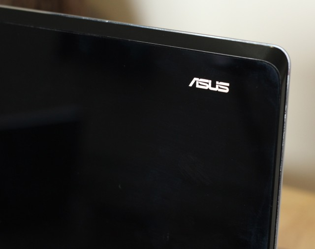 When the computer is in laptop mode, there's a lit-up Asus logo on the back. Also, note that the lid is a fingerprint and smudge magnet.