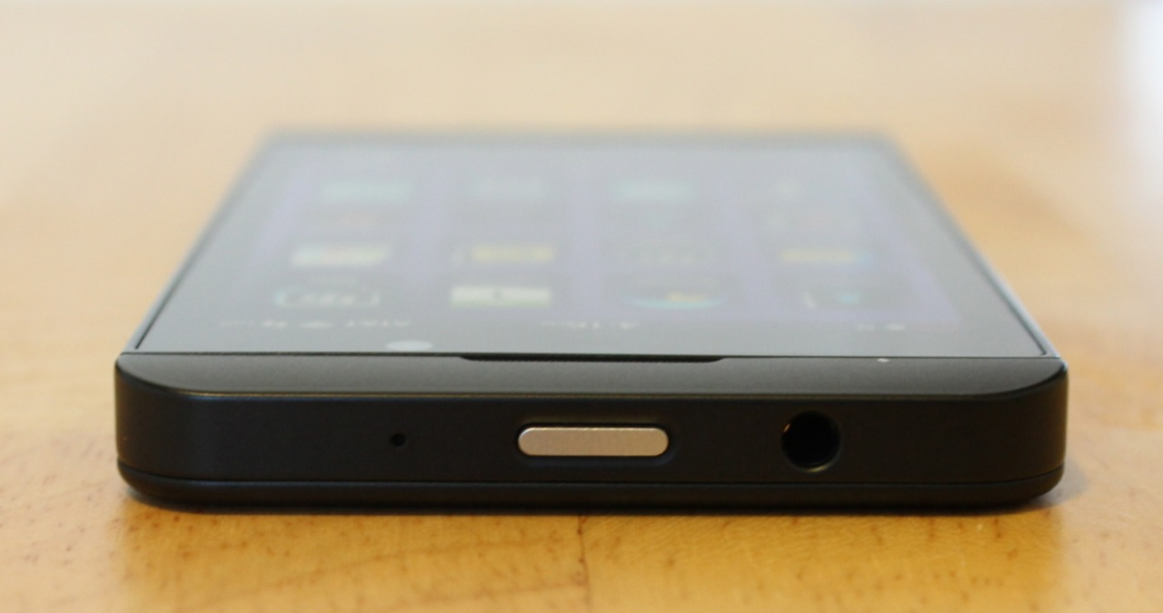 The power/sleep button and headphone jack on the top edge.