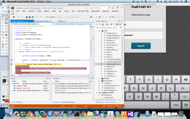 iOS Simulator on the right, pretending to be an iPad. Visual Studio on the left, debugging the iPad.