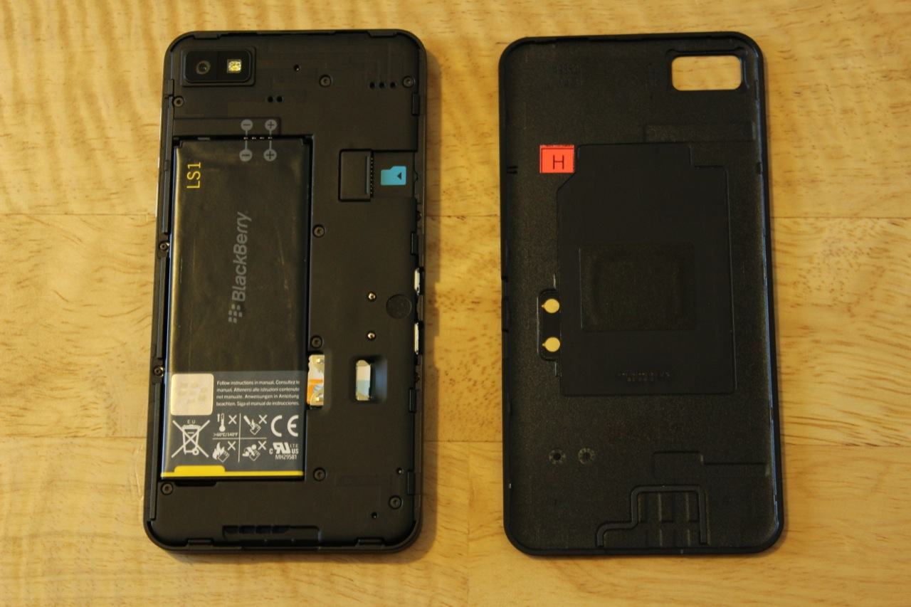 The Z10's back peels off to reveal a SIM card slot, microSD card slot, and removable 1800mAh battery.