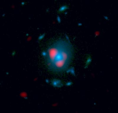 A very distant galaxy, in red, as distorted by the gravity of a closer galaxy (in blue). The light was distorted, forming several images of the same galaxy, bent nearly into a ring.