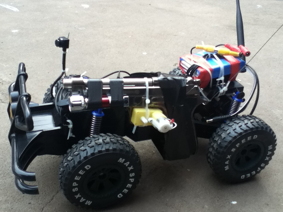 The remote-controlled car, with what I'm pretty sure is an Airsoft pistol taped into place for testing.