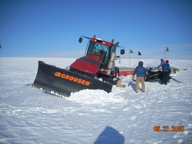 A GrIT towing tractor ensnared by a crevasse.