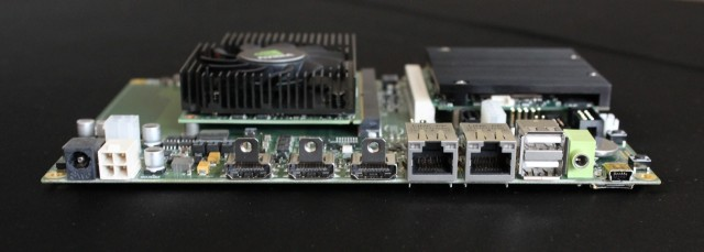 Kayla includes a fairly extensive list of ports and interfaces. The heatsink and fan on the left cools the Kepler GPU, while the passive heatsink on the right cools the Tegra 3 CPU.