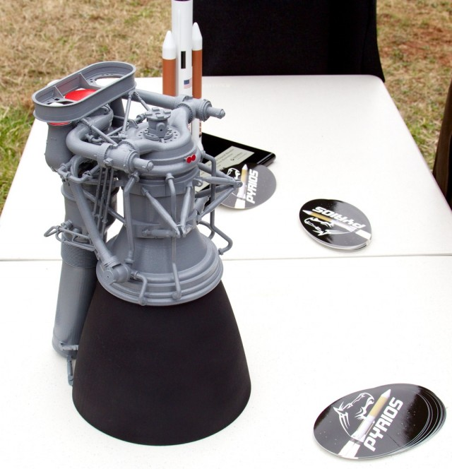 A small model of the proposed F-1B design, on display at the gas generator test firing. Visible in foreground and middle are Pyrios stickers with logo. I grabbed a bunch of these.