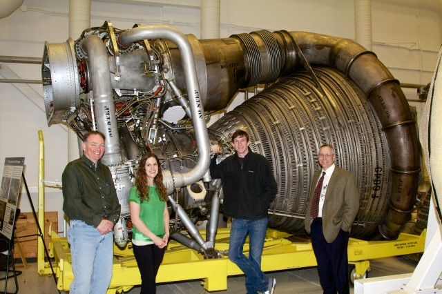 The team that brought the F-1 back to life. From left: R.H. Coates, Erin Betts, Nick Case, and manager Tom Williams. Behind them is engine F-6049. Its gas generator would normally occupy the space just above and to the right of Betts' head—note the white covering in place where the gas generator's exhaust would feed into the turbopump.