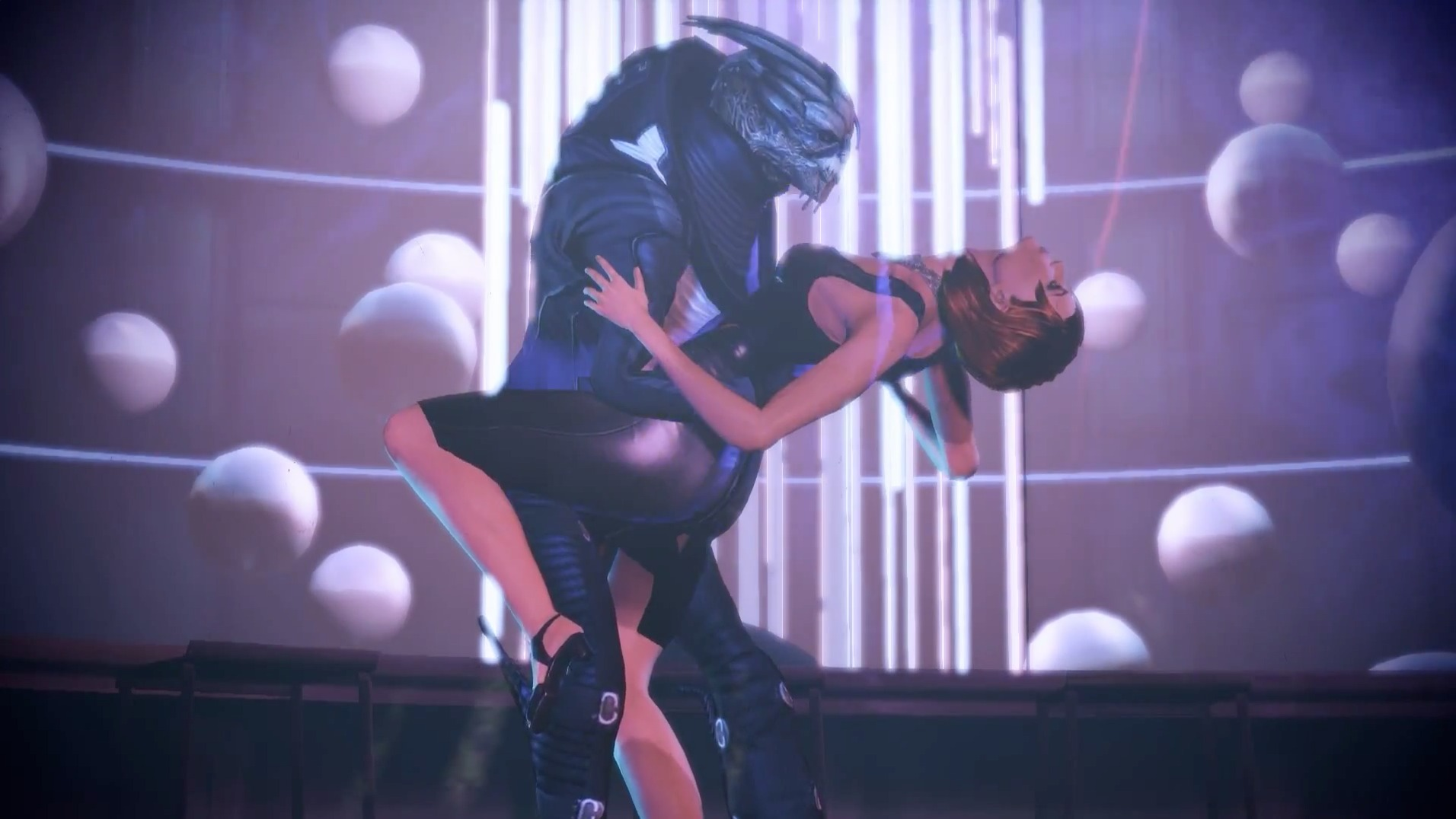 Why, yes, that is Commander Shepard and Garrus Vakarian dancing the tango. This essentially summarizes the tone of the whole DLC pack: it's irreverent, and it's <em>awesome</em>.