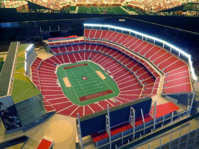 A model of Santa Clara Stadium, with a wall painting visible in the background.