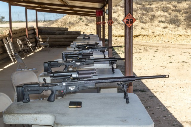 All three PGFs. Foreground is the .338 LM XS1, middle is the .300 WinMag XS2, and rear is the .300 WinMag XS3. .338LM magazine and cartridges are also shown in foreground.