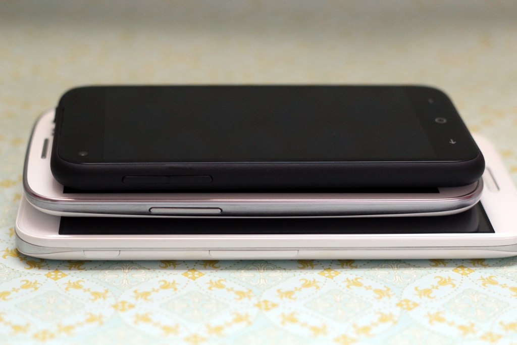 The HTC First stacked on top of the Samsung Galaxy S III, which is stacked on top of the LG Optimus G Pro.