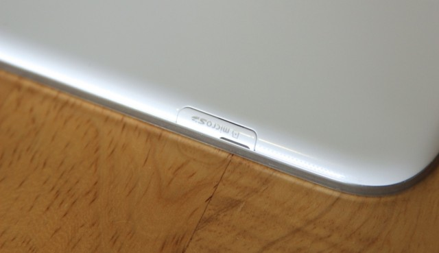 A microSD card slot on the tablet's left side allows for up to 64GB of extra storage.