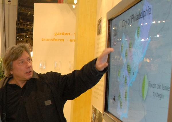 Slavko Milekic shows his touchscreen at the 2008 Philadelphia Flower Show.
