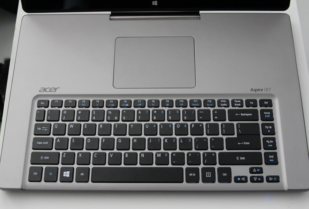 No, you're not tripping: the R7 reverses the conventional positioning of the keyboard and trackpad.