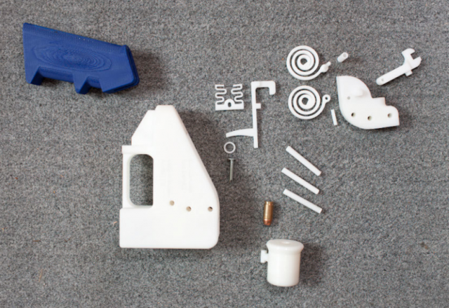 The components of the Liberator pistol, including plastic springs and barrel. Metal nail firing pin visible at center.