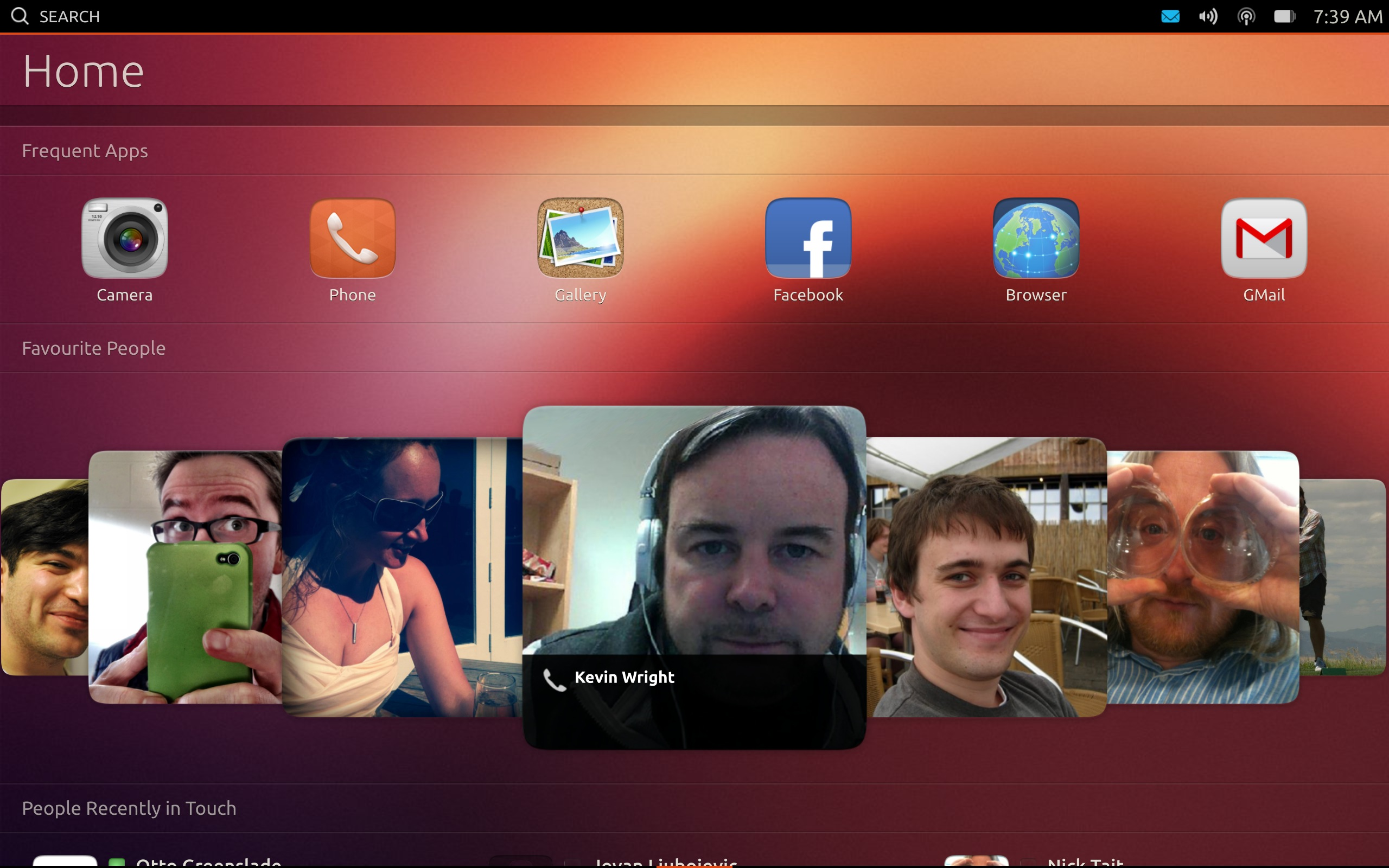 The Home screen on a tablet. Note the larger icons and the Cover Flow-esque area for frequent contacts.
