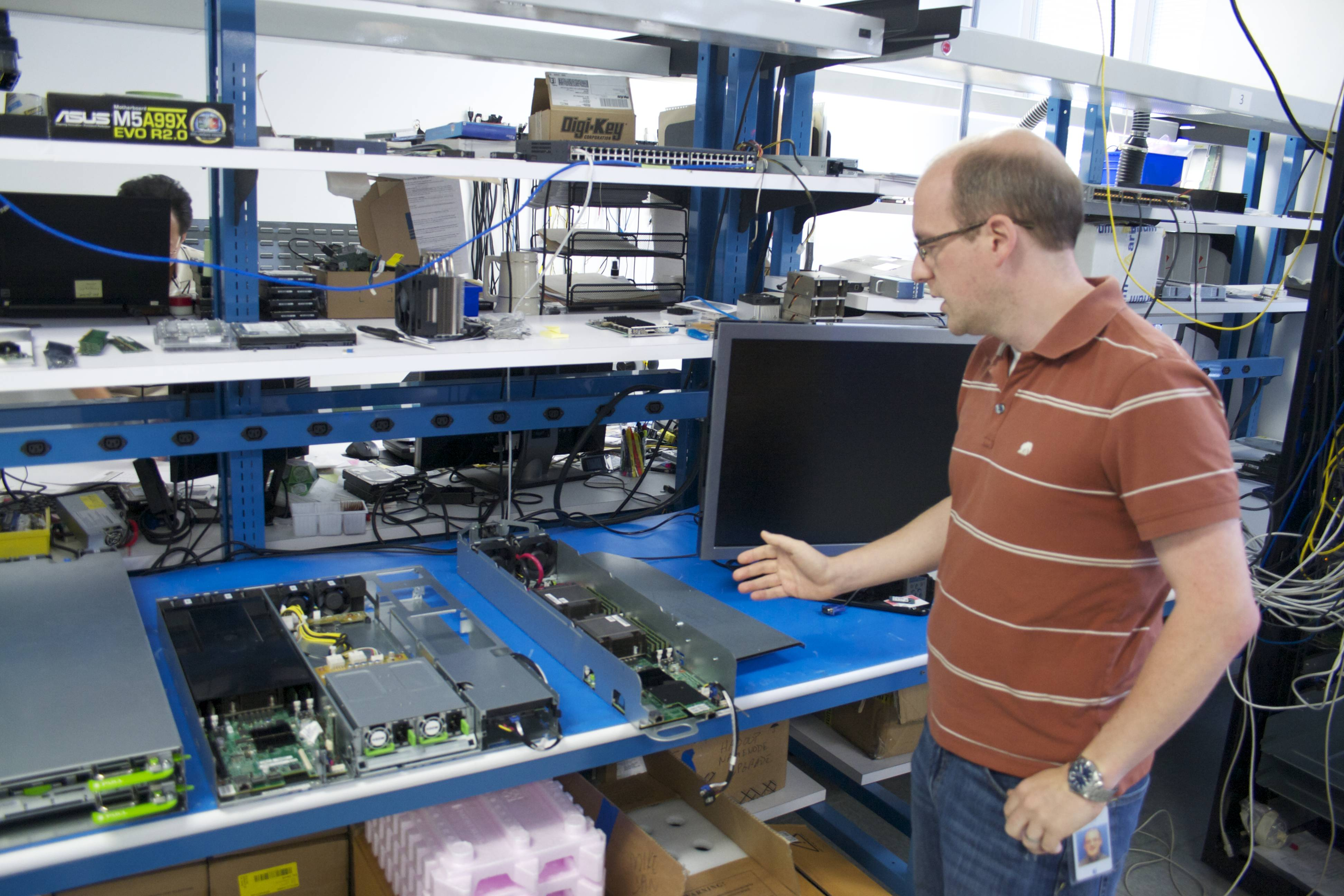 "Facebook's Senior Manager of Hardware Engineering Matt Corddry shows off some of the ""sled"" servers designed and built by Facebook."