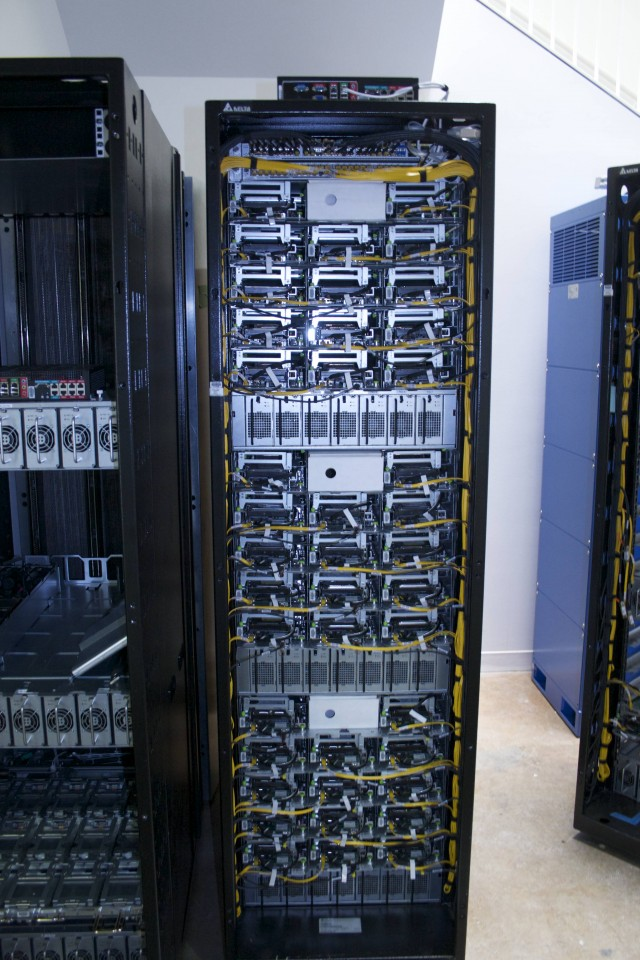 "Fully configured Open Racks with ""professional"" cabling show off Facebook's architecture—network on top, with layers of compute, power, and storage."