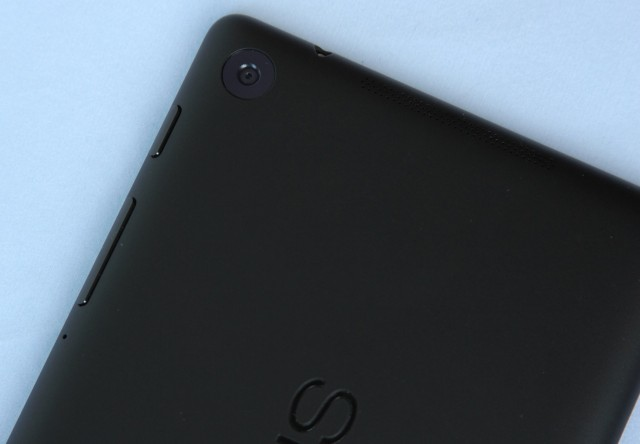 The rear-facing camera. Also note the top of the tablet, where one of the speaker grilles rests.