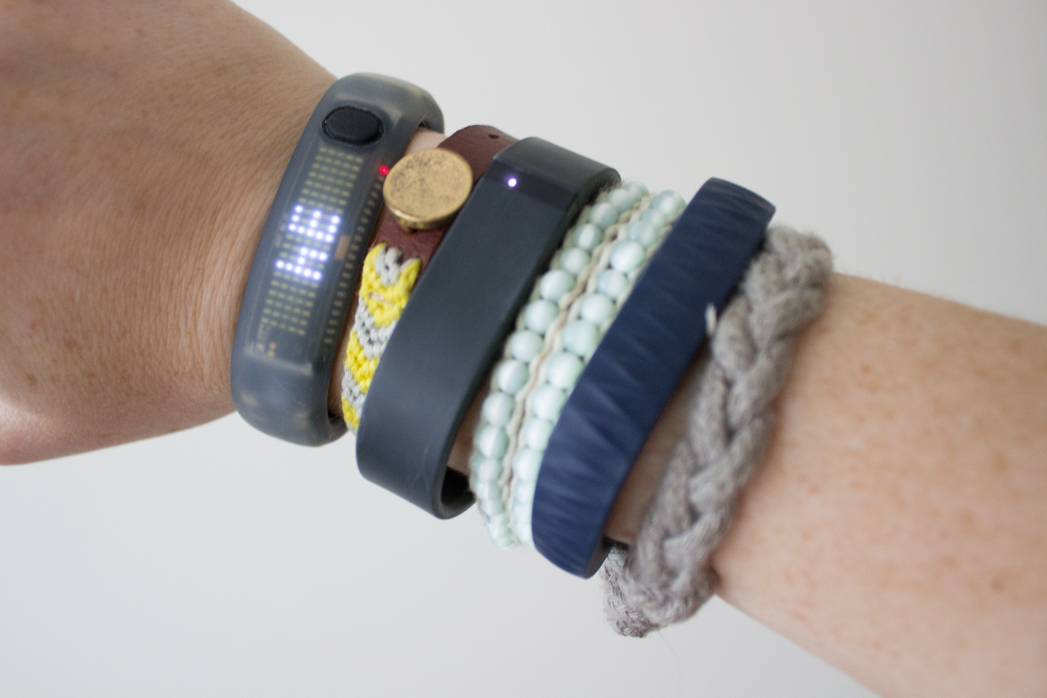 The Nike Fuelband, Fitbit Flex, and Jawbone up, from left to right.
