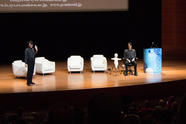 "Dr. Hiroshi Ishiguro onstage with his ""geminoid"" self."