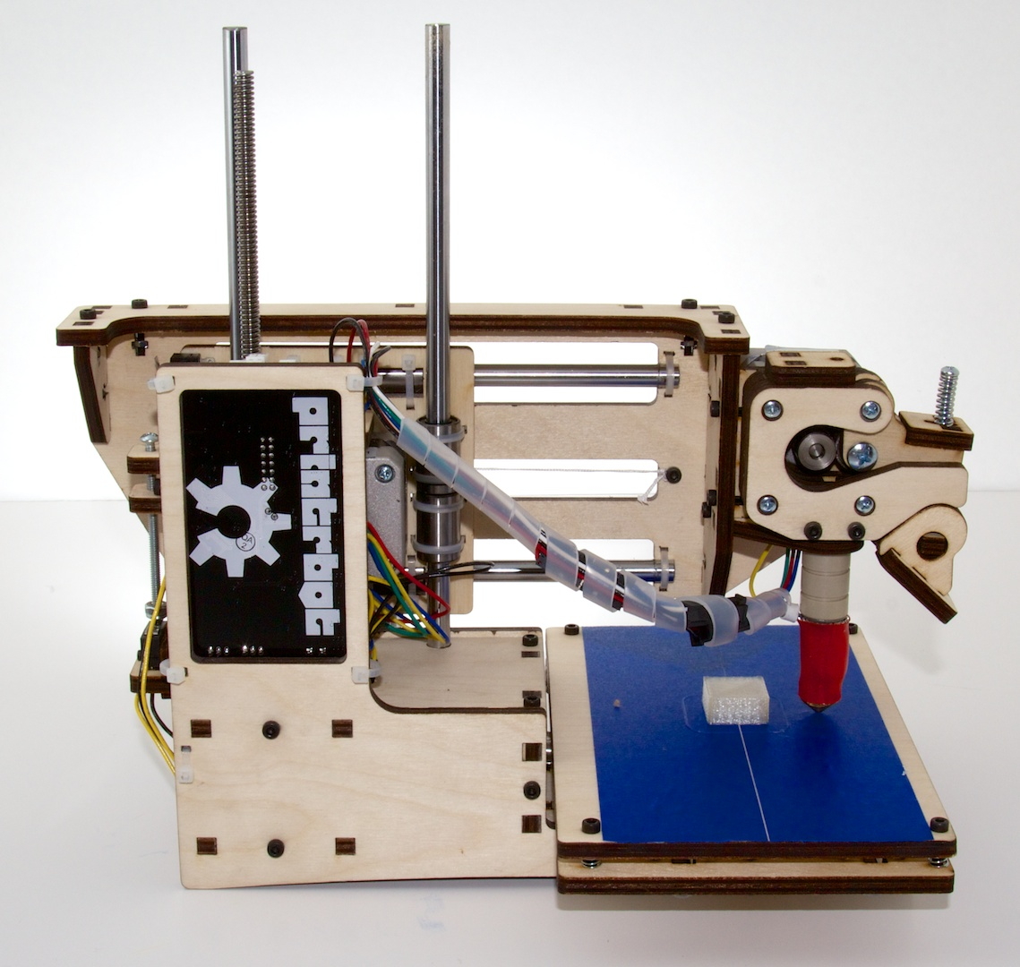The Printrbot Simple, with the factory-printed test object still attached to the bed.