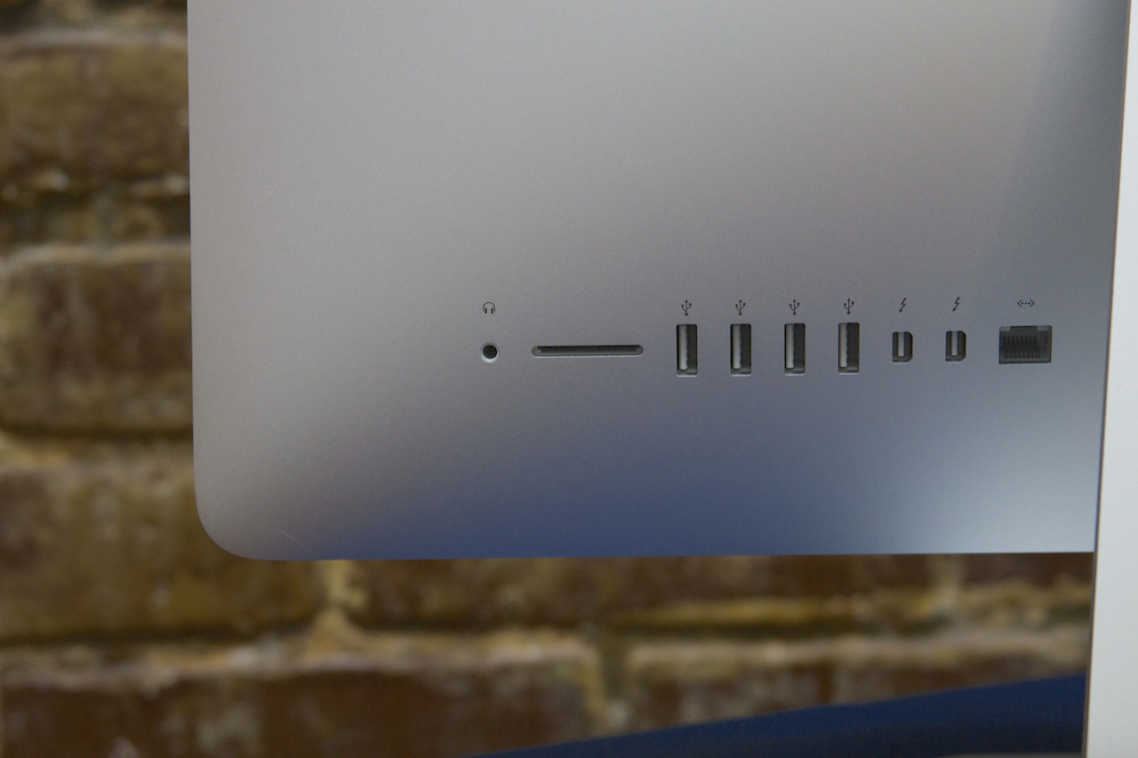 From left to right: headphone jack, SD card slot, four USB 3.0 ports, two Thunderbolt ports, and a gigabit Ethernet port.