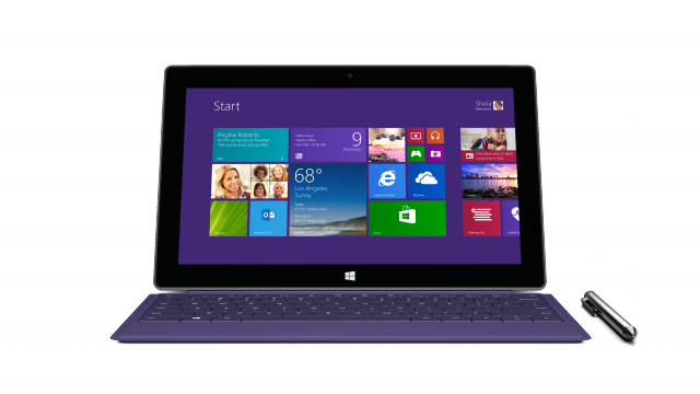 Surface Pro 2 with a purple Type Cover 2. Surface Pro 2 retains the digitizer and pen support of the first generation device.