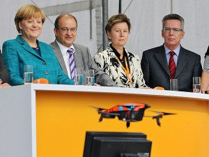 German Chancellor Angela Merkel smiles as a Parrot AR drone comes in for a crash landing during a Christian Democratic Party campaign event September 15.