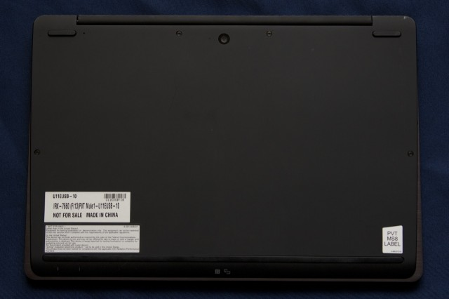 The camera is located on the bottom of the laptop.
