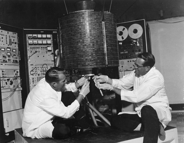 "NASA engineers check out ""EarlyBird,"" Intelsat's first geosynchronous commercial communications satellite, before launch in 1965."