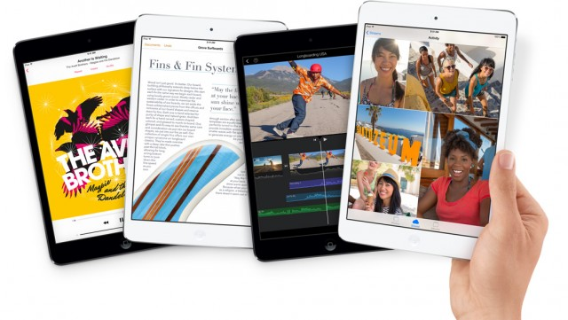 A handful of iPad minis with retina display, in silver and space gray.