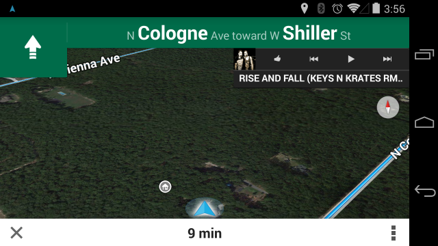 Google Maps Navigation with Google Play Music's widget floating over the top right.