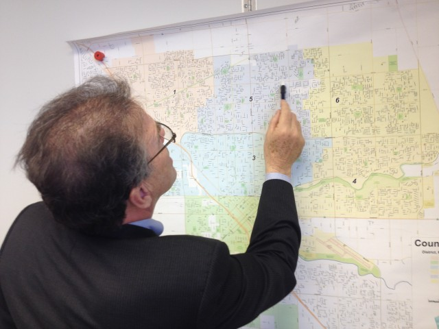 Modesto Mayor Garrad Marsh points out the locations of RLCs on a map of the city.