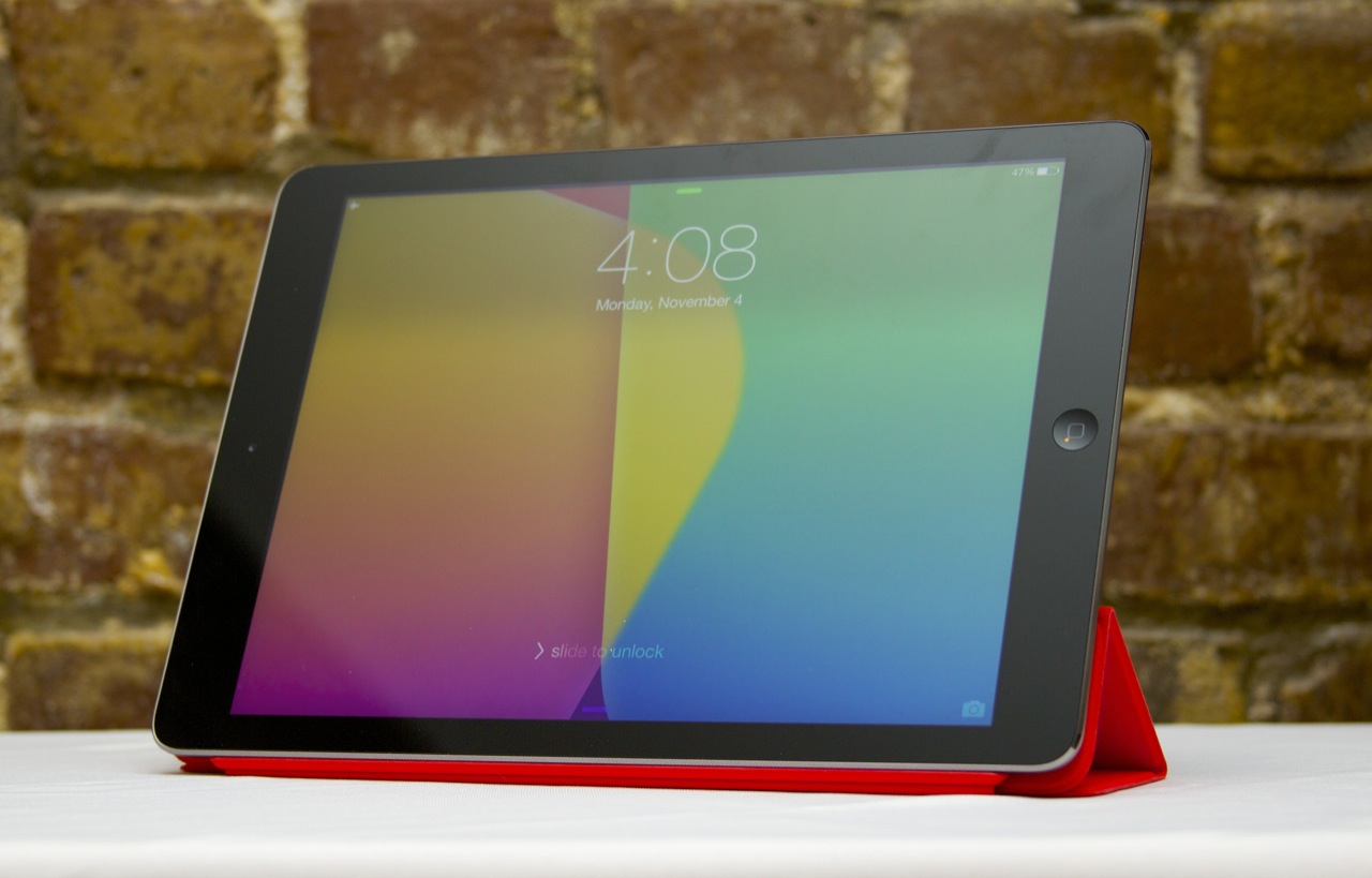 The iPad Air propped up by its new Smart Cover.