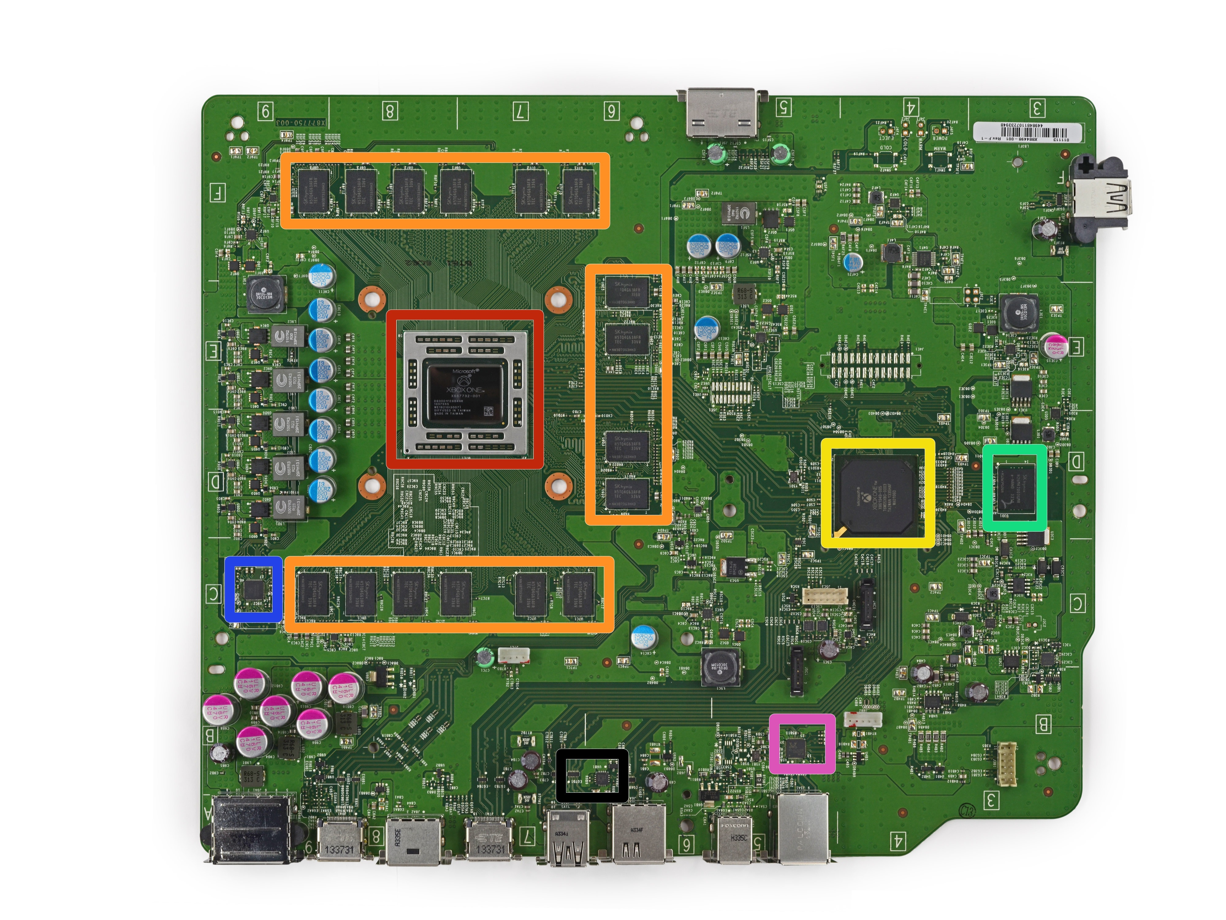 The system's motherboard. The CPU/GPU is outlined in red, and the RAM is highlighted in orange. The green square outlines the system's 8GB of eMMC NAND, which is used for caching.