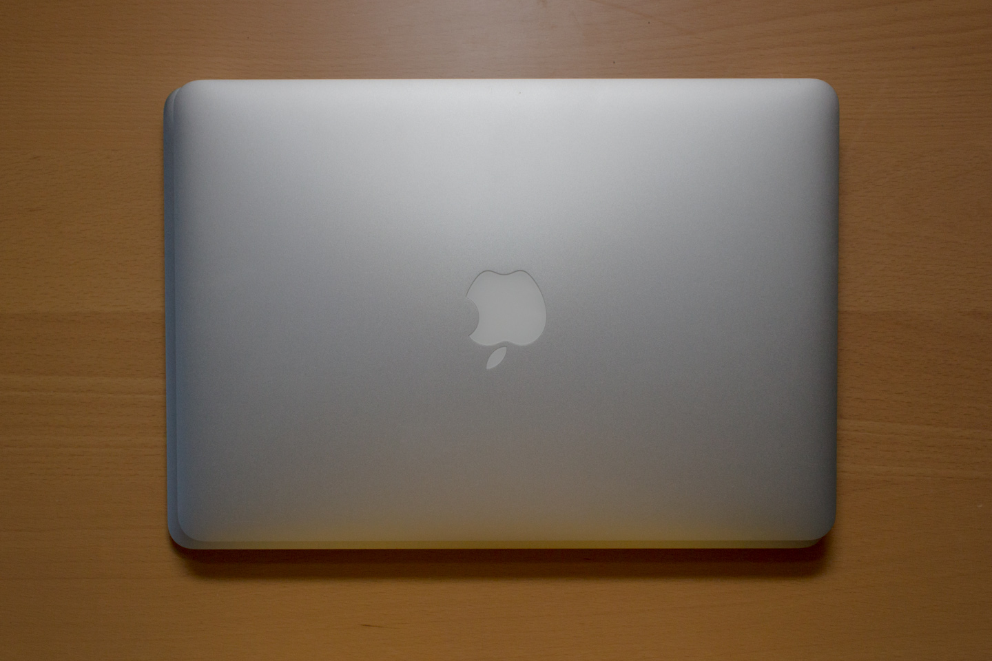 The 13-inch retina MacBook Pro, here stacked on top, is a fraction of an inch shorter in both length and width than the 13-inch MacBook Air.