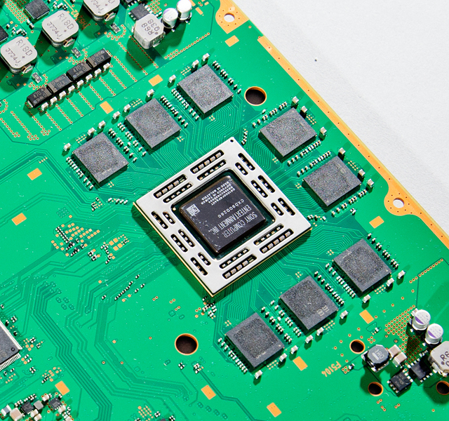 The eight chips surrounding the PS4's main APU each provide 512MB of GDDR5 RAM. Another eight chips on the other side of the board bring the total to 8GB.