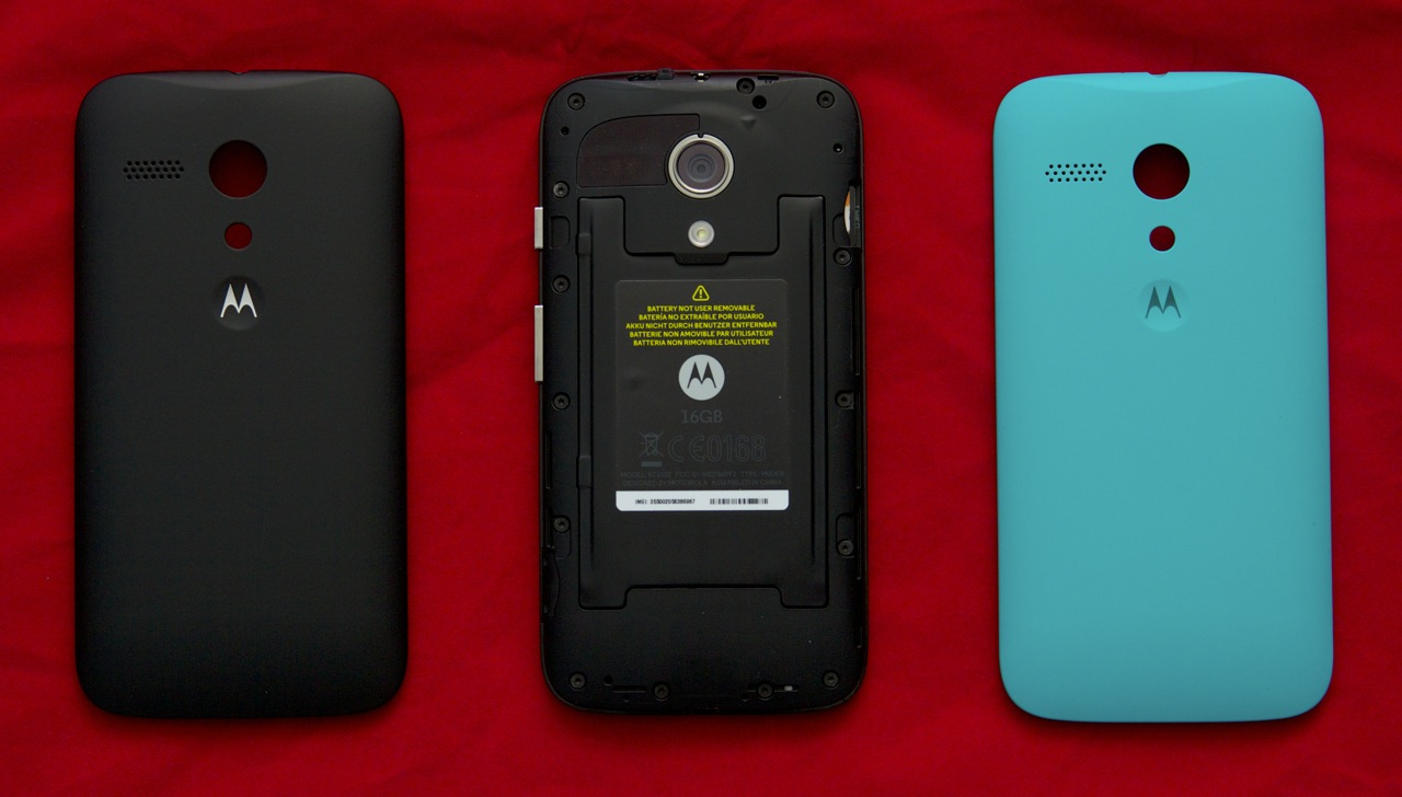 The Moto G's back cover pops off and can be replaced with one of six colorful shells. The default black cover is shown to the left.
