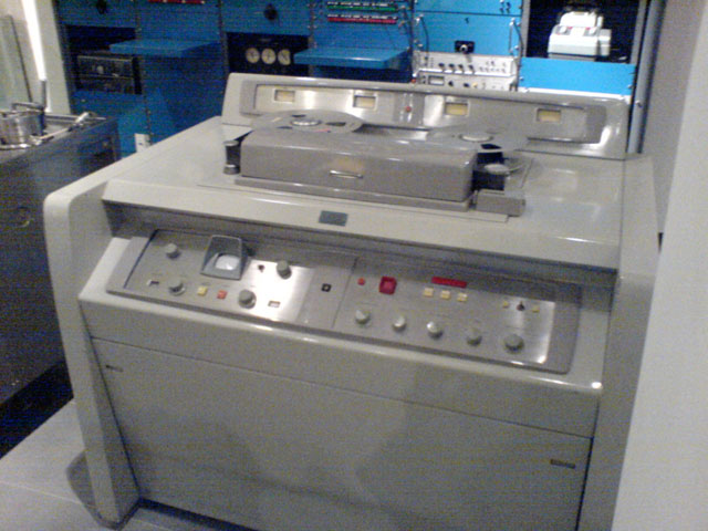 The AMPEX Quadruplex VR-1000-A was the first commercially produced video tape recorder when it was released in 1961. It used 2-inch reel-to-reel tape.