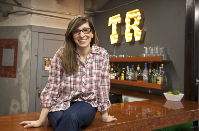 Leah Busque, founder of Task Rabbit, at the bar her husband built for company happy hour (located in the Task Rabbit office in San Francisco).